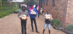 Children proud and happy collecting their food parcels during Covid